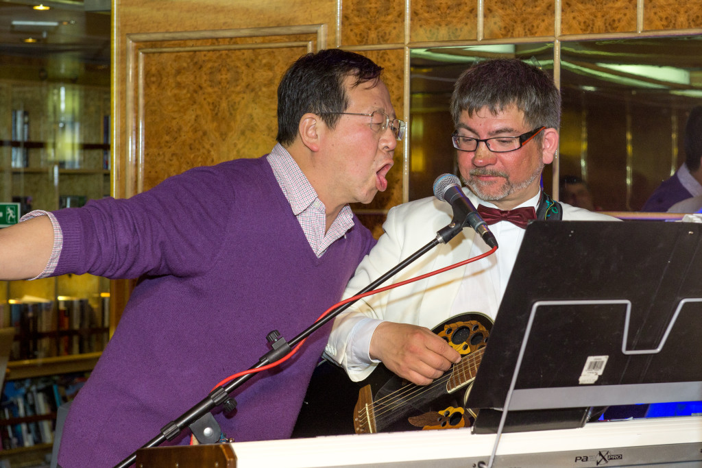 This guy from the Chinese group got very drunk and kept trying to steal the microphone from the ship musician.